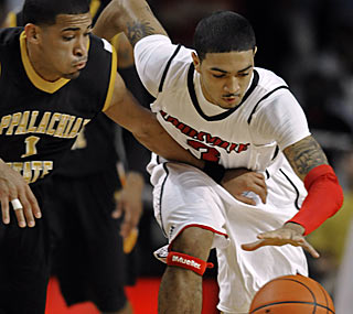 Louisville's Peyton Siva scores just five points off the bench, but leads the team with four steals.  (AP)