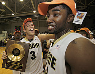 Chris Kramer and E'Twaun Moore rejoice after wrapping up a Paradise Jam title for Purdue.  (AP)
