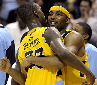 Jimmy Butler and Lazar Hayward embrace after combining for 39 points for Marquette. (AP)