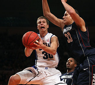 Tournament MVP Jon Scheyer leads Duke with 19 points to topple UConn.  (Getty Images)