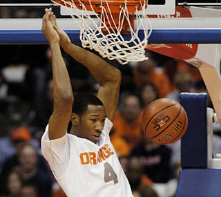The Orange get plenty of help from Wes Johnson, who compiles 19 points, nine boards and five assists.  (AP)