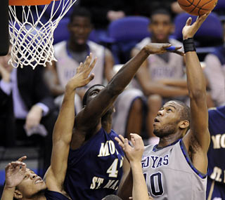 Greg Monroe (19 points, 11 boards) creates a mountain of problems for Mount St. Mary's.  (AP)