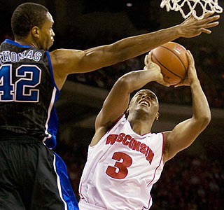 Trevon Hughes takes it hard to the hoop for two of his career-high 26 points for Wisconsin.  (US Presswire)