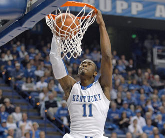 John Wall finishes off two of his 19 points as UK continues its best start in more than 30 years.  (AP)