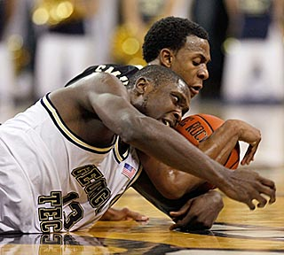 Georgia Tech's D'Andre Bell (front) battles Wake Forest's Ishmael Smith for a loose ball.  (Getty Images)