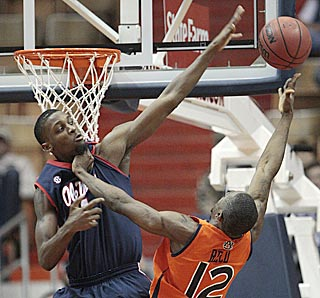 Terrence Henry (left) and Ole Miss successfully fend off DeWayne Reed and host Auburn.  (AP)