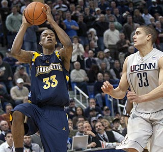 Marquette's Jimmy Butler goes up for the winning hoop as Gavin Edwards closes in. (AP)