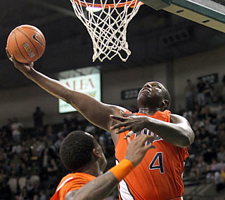 Junior Derrick Caracter lends a hand by notching 20 points and 13 rebounds in the Miners' 2OT win. (AP)
