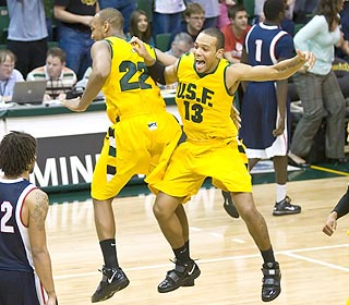 That's right, jump. The Dons celebrate after ending Gonzaga's conference winning streak. (US Presswire)