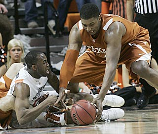 Texas center Dexter Pittman snatches a loose ball from OSU guard James Anderson in the first half.  (AP)