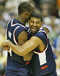 Emeka Okafor (left) and Rashad Anderson celebrate the victory. (Getty Images)