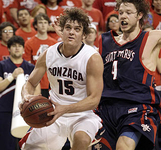 Matt Bouldin scores 18 points as Gonzaga earns 20 wins for the 13th consecutive season.  (AP)