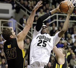 Held to six points in his last game against Iowa, JaJuan Johnson strikes back with 21 this time.  (AP)