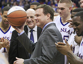 Kansas coach Bill Self receives the game ball after the 400th victory of his career. (AP)