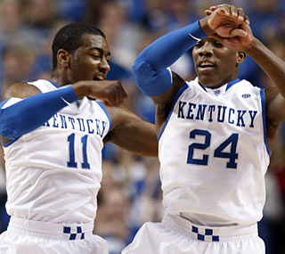 Kentucky's John Wall (11) and Eric Bledsoe (24) combine for 40 points to spark the Wildcats.  (AP)