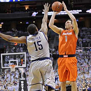 Andy Rautins' season-high 26 points help the Orange hold off a late flurry from the Hoyas. (AP)