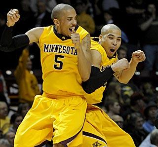 Devoe Joseph (left) and Justin Cobbs celebrate a victory that boosts Minnesota's bid for the NCAAs. (AP)