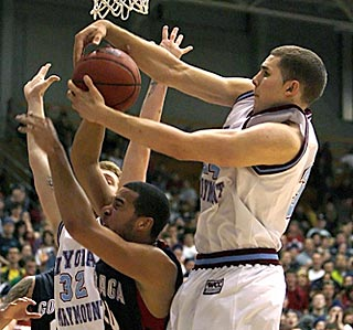 LMU's Drew Viney (right) takes the ball from Gonzaga's Elias Harris in the second half.  (AP)