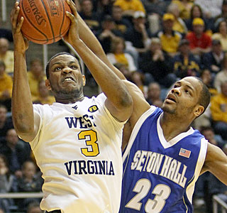 Devin Ebanks scores 16 points to help West Virginia fight off a late charge by Seton Hall.  (AP)