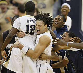 Ashton Gibbs is crowded by his teammates after burying the game winner at the buzzer. (AP)