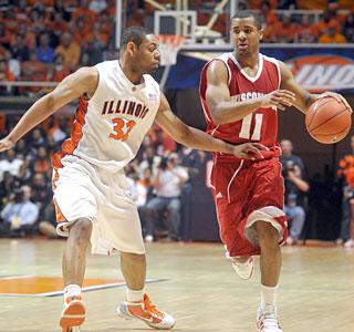 Jordan Taylor plays better this time against Illinois, tying for the team lead with 20 points.  (AP)