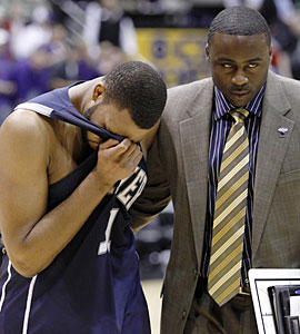 Xavier's Jason Love needs to be consoled after the emotionally draining game. (AP)