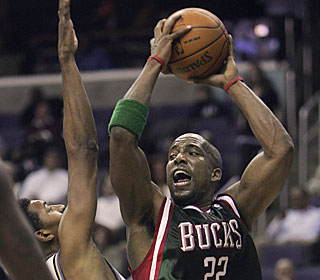 Michael Redd makes 11 of 20 attempts from the field during his team-high 29 point performance.  (AP)
