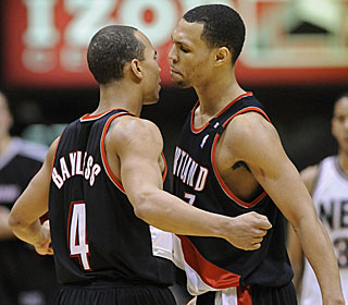 Jerryd Bayless (23 points) and Brandon Roy (29) help the Blazers rally from an 11-point hole.  (AP)