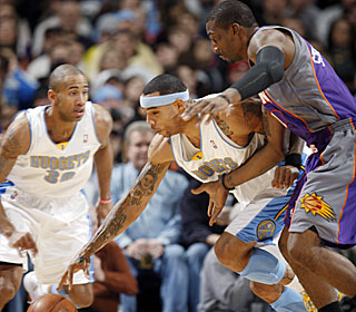 Nuggets forward Kenyon Martin goes off for 24 points, eight rebounds and seven steals in the victory. (AP)