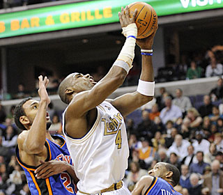 Antawn Jamison takes a beating but keeps on ticking, going for 28 points.  (AP)