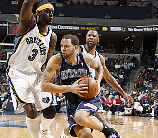 Darius Miles discovers it's tough to stay in front of Deron Williams, who scores 27.  (Getty Images)