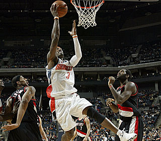 Gerald Wallace plays like a big man, scoring 31 points and pulling down 16 boards.  (Getty Images)