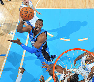 Dwight Howard puts up 14 points and 20 rebounds to help the Magic finish a 4-0 trip.  (Getty Images)