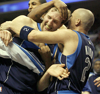 Dirk Nowitzki is the hero for the Mavericks, turning a poor shooting day around with one basket.  (AP)