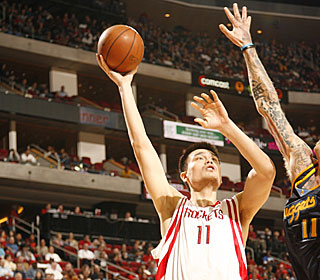 Yao Ming is too much for the Nuggets frontcourt to handle, scoring 31 points.  (Getty Images)