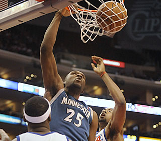 Al Jefferson goes 9-for-21 from the field for the Wolves, who have won seven of eight. (AP)