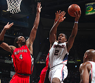 Joe Johnson, who pours in a game-high 28 points, attacks the Raptors defense.  (Getty Images)