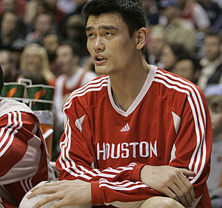 Talk about big trouble: Yao Ming leaves the game with soreness in his right knee.  (AP)