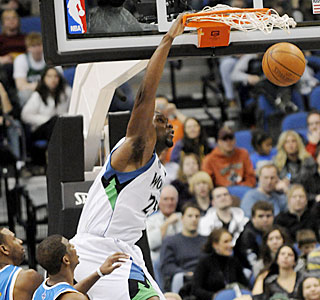 Al Jefferson takes advantage of the Hornets' thin frontline, dunking two of his 24 points.  (AP)