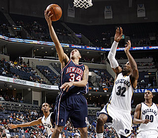 Devin Harris gets through the Grizzlies defense for two of his 17 points.  (Getty Images)