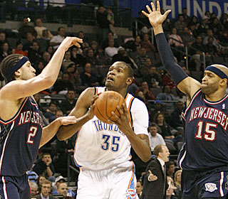 Kevin Durant gets half of his 18 points in the decisive third quarter for the Thunder.  (AP)