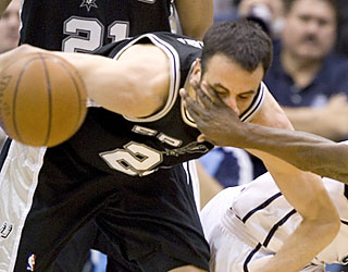 Manu Ginobili takes advantage of numerous Utah fouls by sinking all eight free throws in the fourth.  (AP)