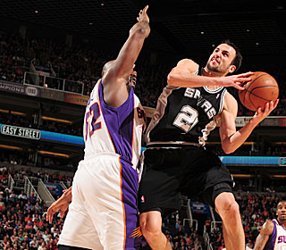 Manu Ginobili attacks the rim most of the game, making all 18 of his free throws.  (Getty Images)