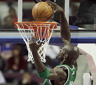 Kevin Garnett goes above the rim en route to 22 points as the Celtics go to 3-0 vs. the Pistons.  (AP)