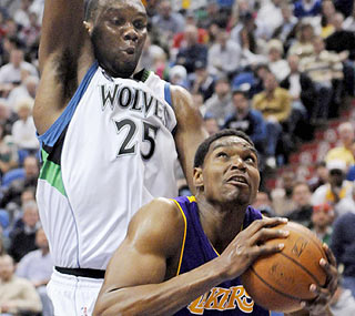 Andrew Bynum drops his fifth straight double-double with 27 points and 15 rebounds.  (AP)