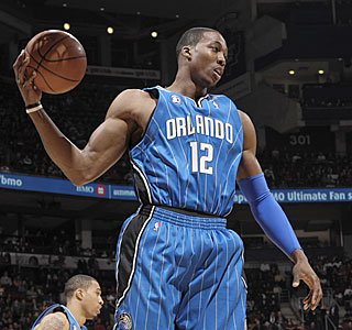 Dwight Howard corrals one of his 14 boards, matching his league-leading season average.  (Getty Images)