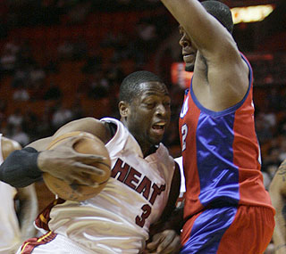 The Clippers can't stop Dwyane Wade and the Heat, who are 15-3 when they score 100 or more.  (AP)