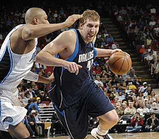 Dirk Nowitzki opts to put away his patented jumper on this drive during his 29-point outing.  (Getty Images)