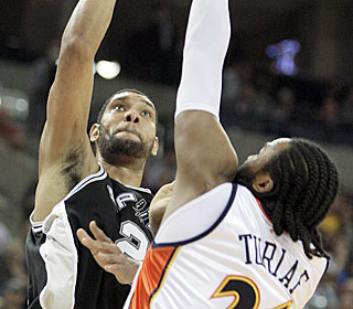 Tim Duncan goes off for 32 points, 15 rebounds and five assists for his 30th double-double.  (Getty Images)