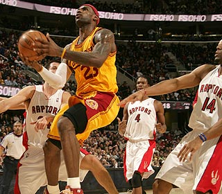 Count 'em: Three defenders can't stop LeBron from scoring two of his 33 points. (Getty Images)